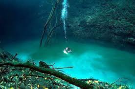 coming out of the cloud in cenote angelita
